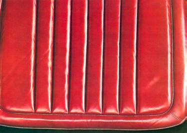 Detail of Red Leather Aircraft-Type Seats