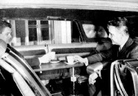 Busy executives have a discussion over coffee in the 1966 Imperial Mobile Executive Show Car (click for larger view)