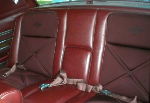 Standard Dark Red Knit Cloth and Vinyl interior - rear seat shown