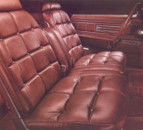 Leather with Vinyl Option interior trim in Saddle