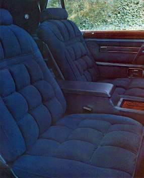 Front bucket seats are trimmed in Midnight Blue Kasman II Luxury Cloth