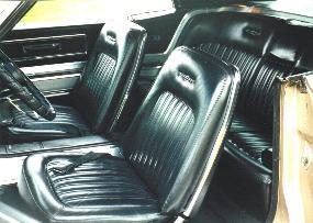 Front bucket seats and console/coved rear seat